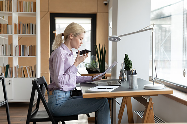 female-millennial-entrepreneur-giving-command-to-virtual-assistant